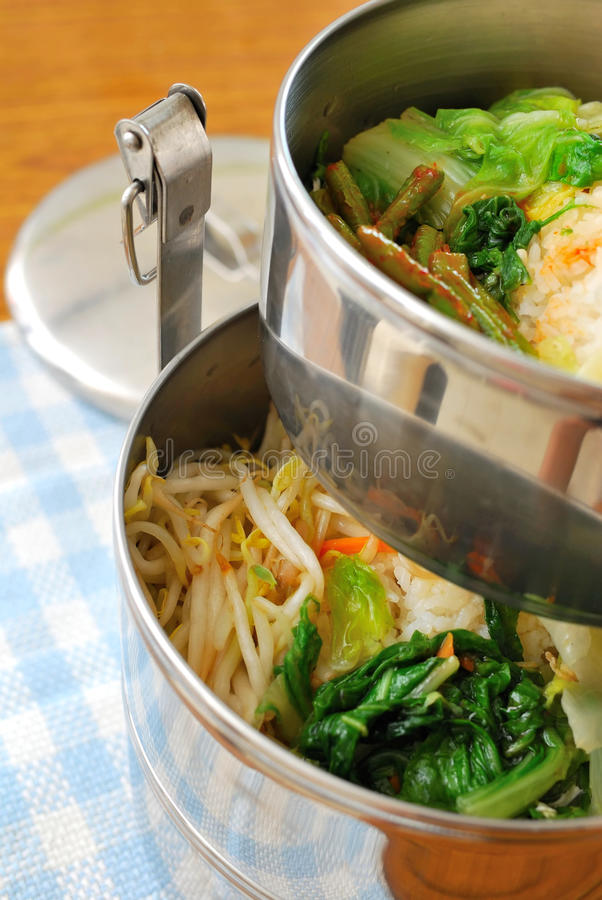 Takeout meals. In metal containers. For concepts such as diet and nutrition, busy work life, and food and beverage stock photo