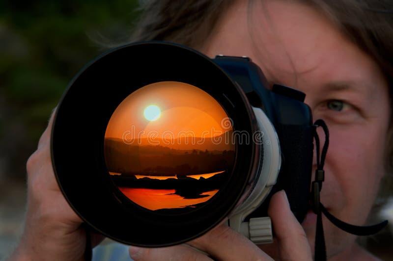 takes för fotografbildsolnedgång royaltyfri fotografi