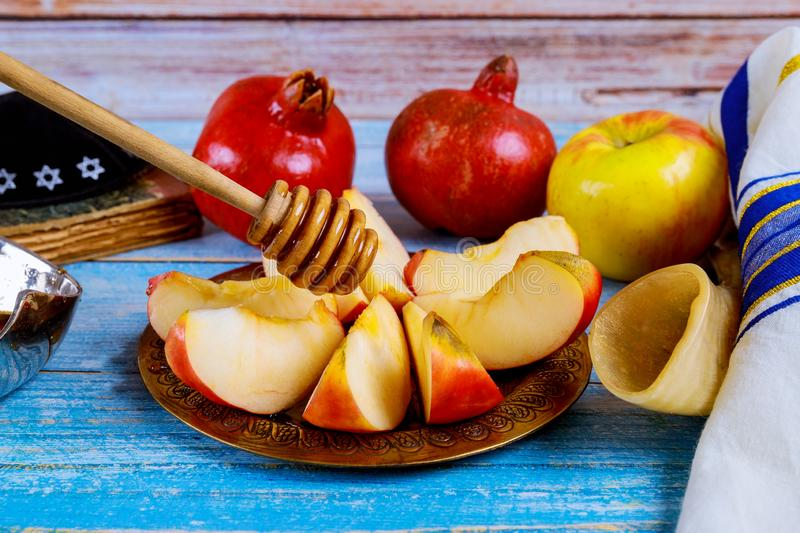 A takes a with honey for the apple slice and pomegranate holiday of Rosh Ha Shana. Jewish prays at the praying book, holidays, new, year, hashana, yom, kippur stock images