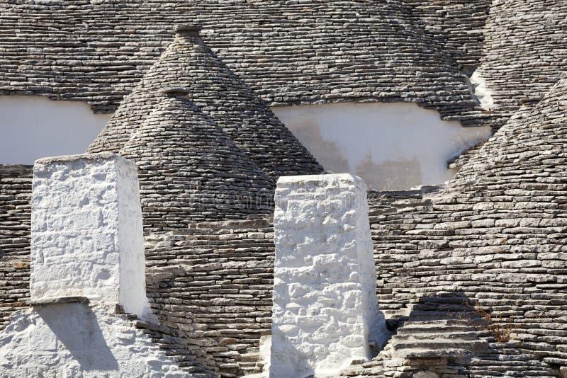 Taket stenar trulli av Alberobello Puglia sydliga Italien arkivfoto