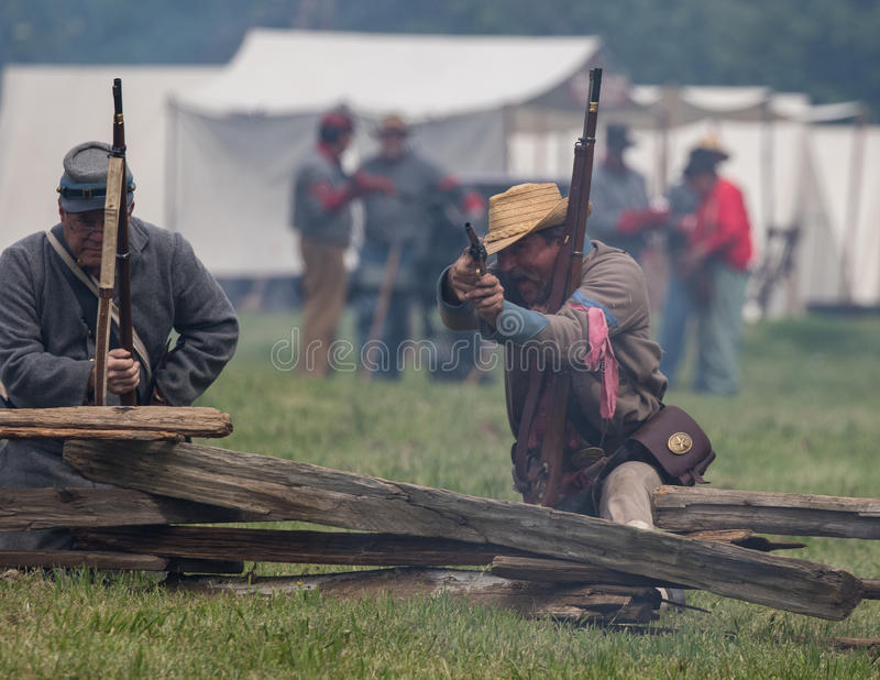 Taking Aim. Civil War era soldiers in battle at the Dog Island reenactment in Red Bluff, California royalty free stock photo