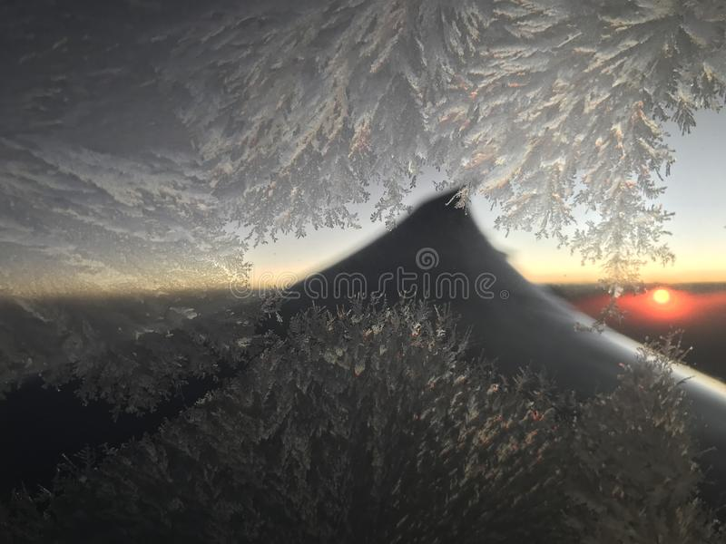 Flying through the dawn sky with frost on the window royalty free stock photos