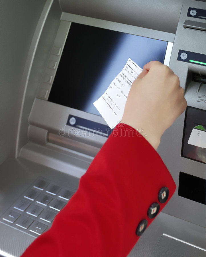 Taking ATM deposit slip. This photograph represent a women hand taking a deposit slip from ATM machine stock photography