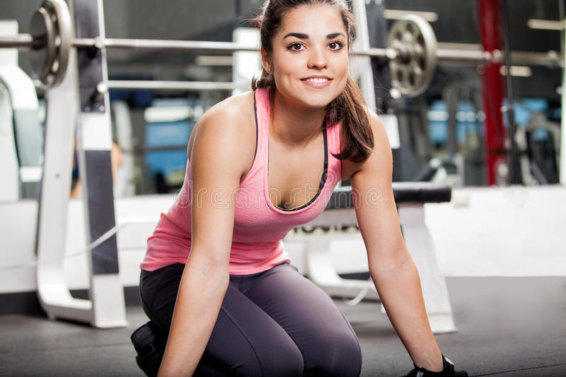 Taking a break at the gym. Cute girl taking a break from a workout at the gym and smiling stock image