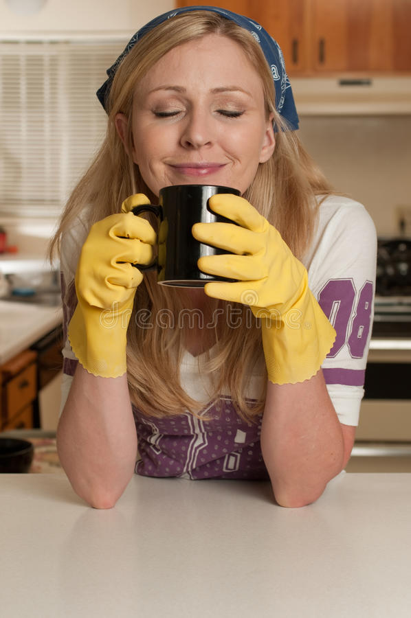 Taking a break from housework royalty free stock photos