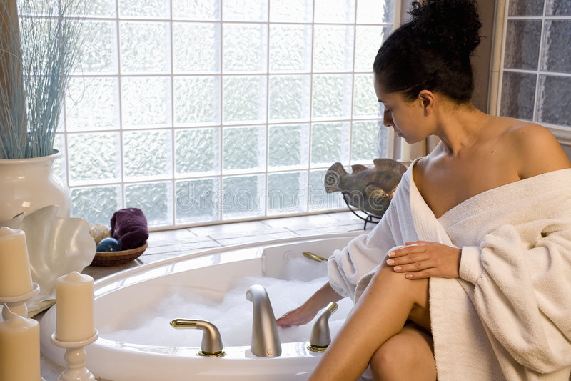 Taking a bubble bath stock photo