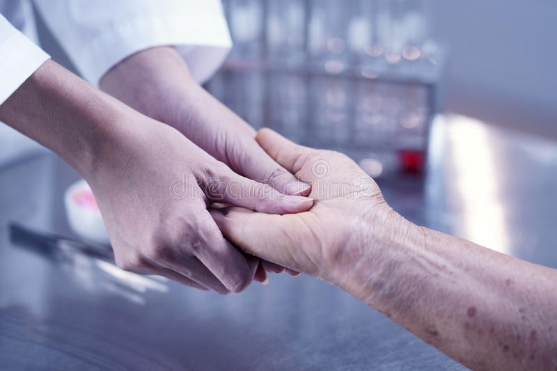 Taking care of the elderly people, Doctor comforting patient, as stock images