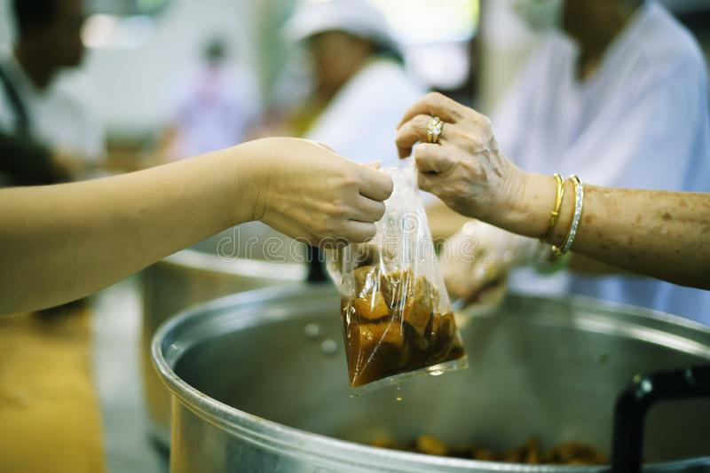 Taking care of the homeless by sharing food is the hope of the poor : the concept of begging and hunger.  stock images