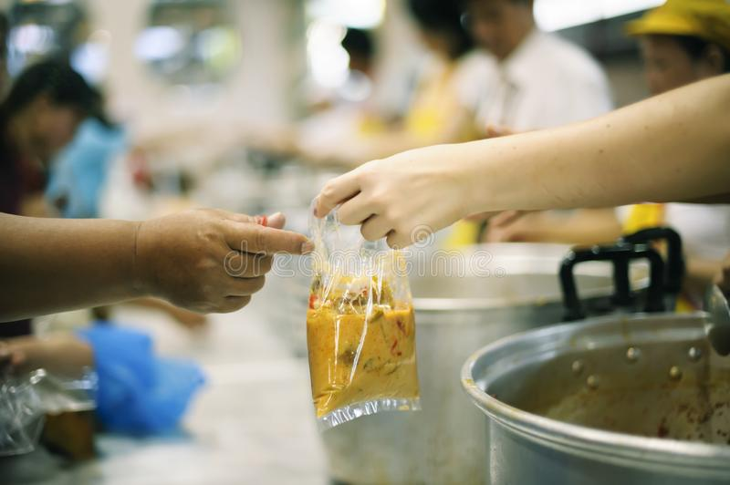 Taking care of the homeless by sharing food is the hope of the poor : the concept of begging and hunger.  royalty free stock images
