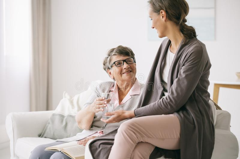 Taking care of older woman royalty free stock photography