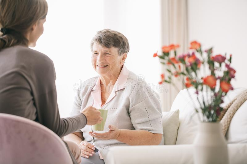 Taking care of older woman stock photos