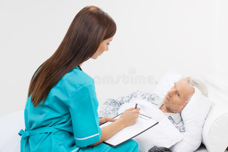 Taking care of seniors. stock photos