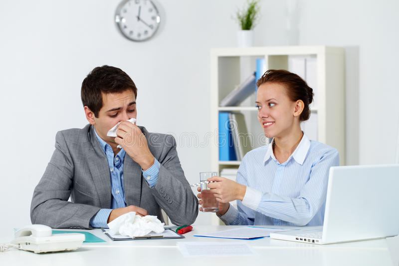 Taking care of sick co-worker royalty free stock photos