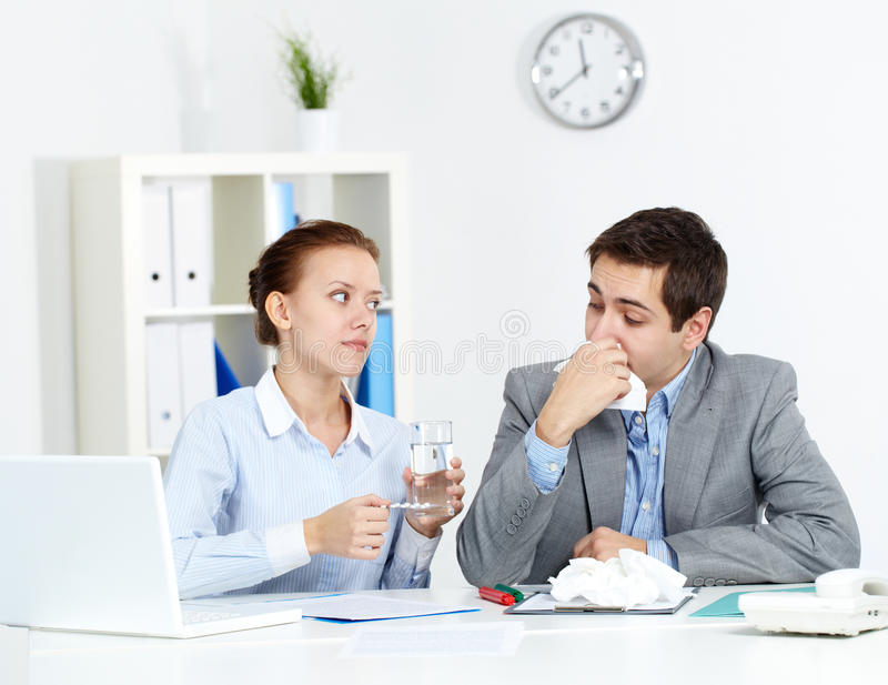 Taking care of sick co-worker stock photography