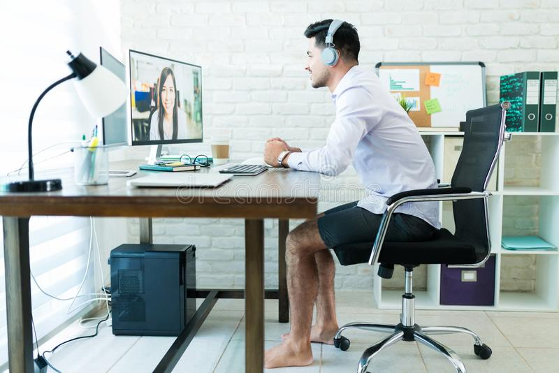Taking conference call comfortably at home stock photos