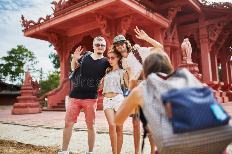 Taking group photo in front of temple in thailand stock images