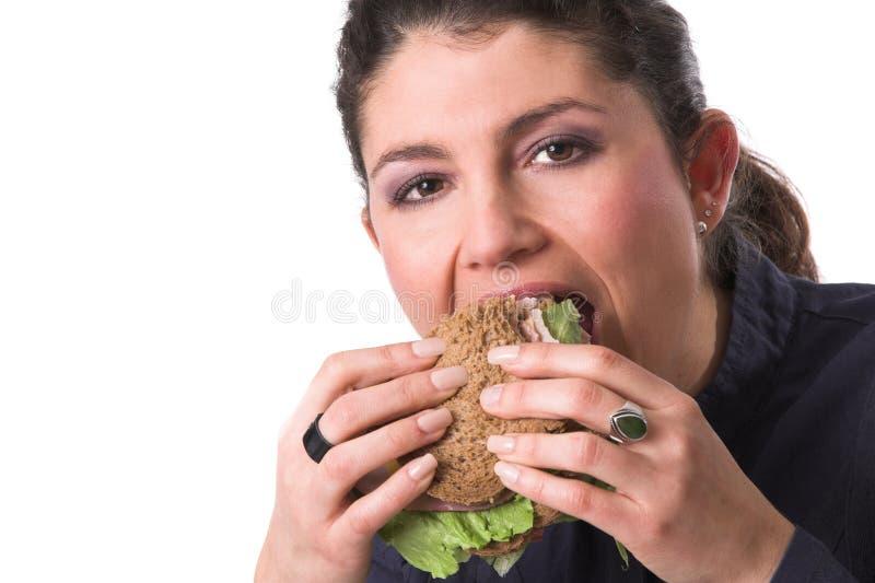 Download Taking a healthy bite stock photo. Image of bread, pretty - 1712564