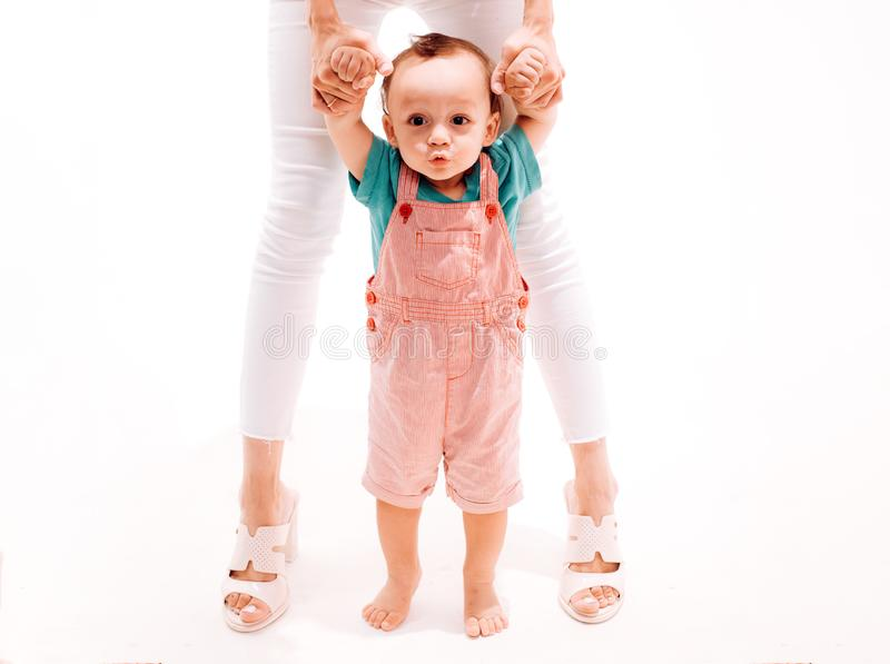 Taking his first steps. Adorable small toddler. Little boy child develop gross motor activity. Little baby learn to walk. Small child walking with help, motor royalty free stock photo