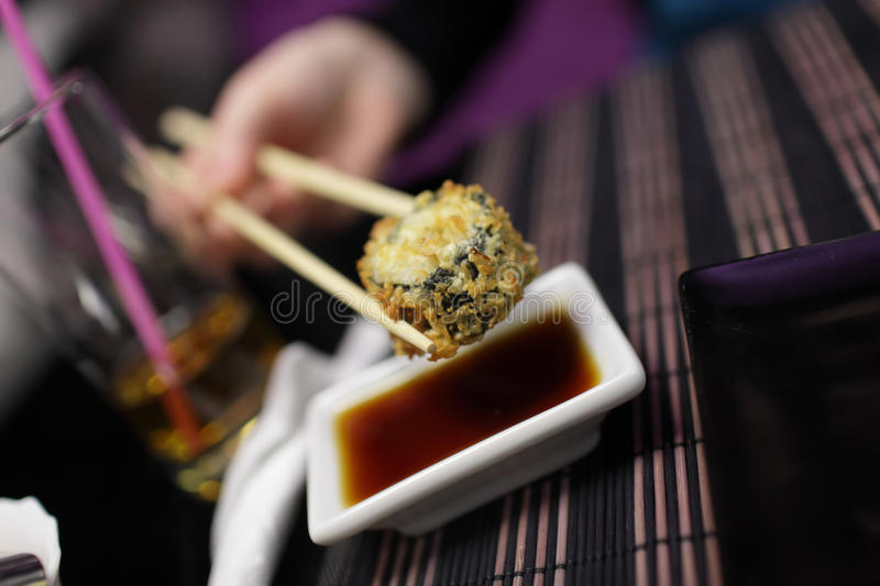 Download Taking of hot roll stock photo. Image of plate, chopsticks - 23113518