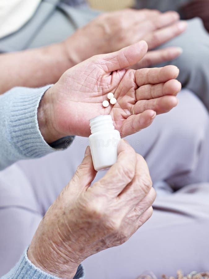 Woman taking medication - Stock Image - M626/0266