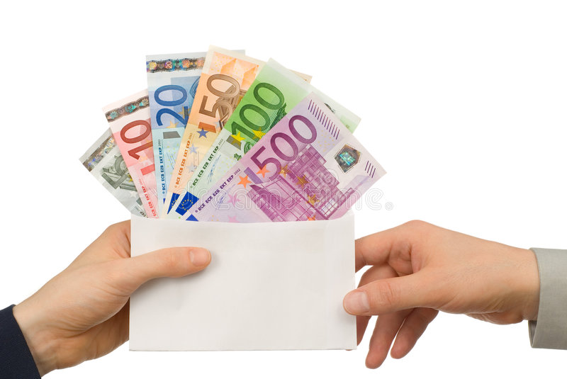 Taking money in an envelope. Isolated studio shot of Euro notes in an envelope being handed from one person to another stock photography