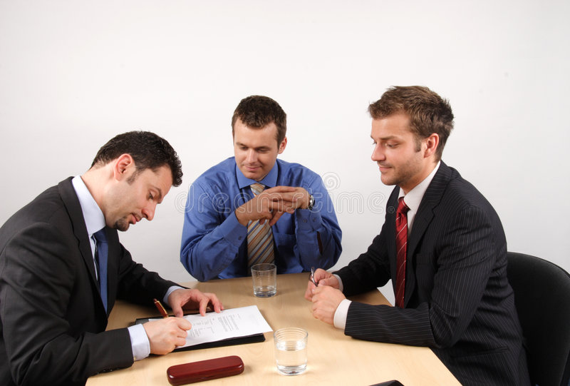 Taking a new job. Businessmen negotiation and signing a contract stock image