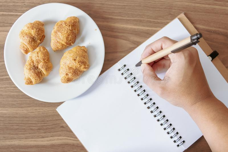 Taking notes at breakfast royalty free stock images
