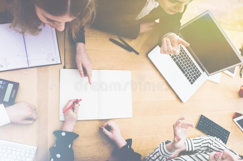 Taking notes with pen and paper in small business meeting royalty free stock photography
