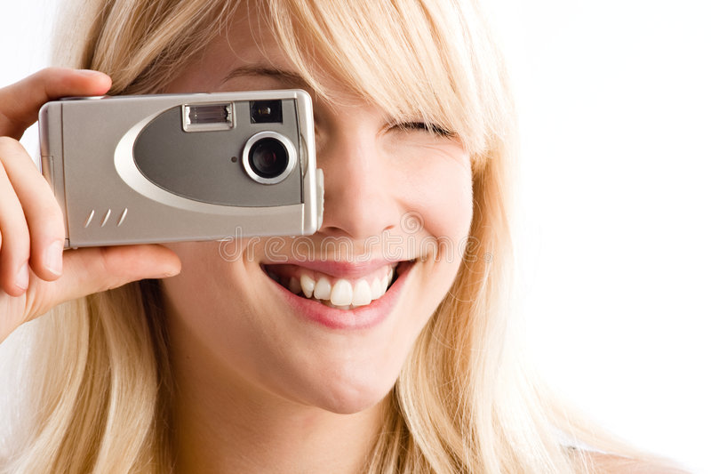 Taking photo. Woman taking photo with small digital camera stock photo