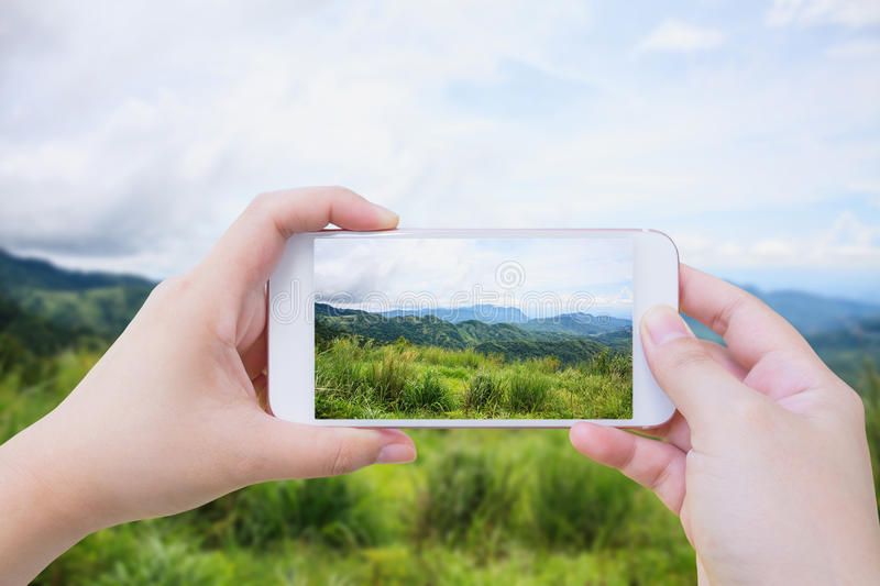 Taking photo of Beautiful landscape in the mountains royalty free stock photos