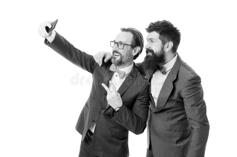 Taking photo with business idol. Selfie of successful friends. Entrepreneurs taking selfie together. Business people royalty free stock image