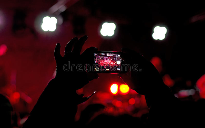 Taking photo at concert royalty free stock image
