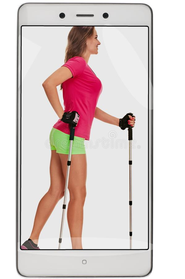 Nordic walking woman. Taking photo of nordic walking woman on mobile phone. conceptual collage with device royalty free stock photo