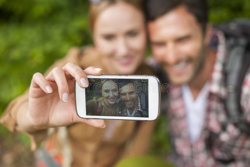 Taking photo. One selfie to memorize this moment royalty free stock images
