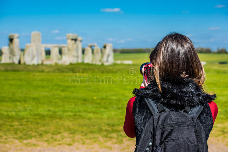 Taking a photo of Stonehenge royalty free stock photo