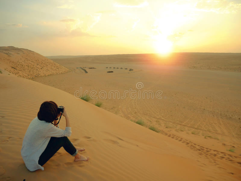 Taking photo of sunset in Wahiba desert, Oman stock image