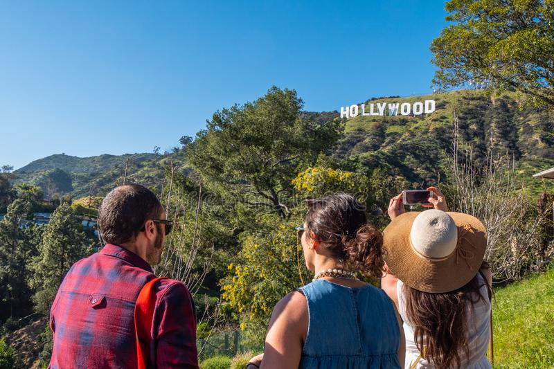 Taking photos at the Hollywood sign - CALIFORNIA, USA - MARCH 18, 2019. Taking photos at the Hollywood sign - CALIFORNIA, UNITED STATES - MARCH 18, 2019 royalty free stock images