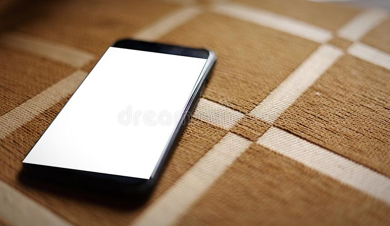 Smart Phone on floor color brown royalty free stock image