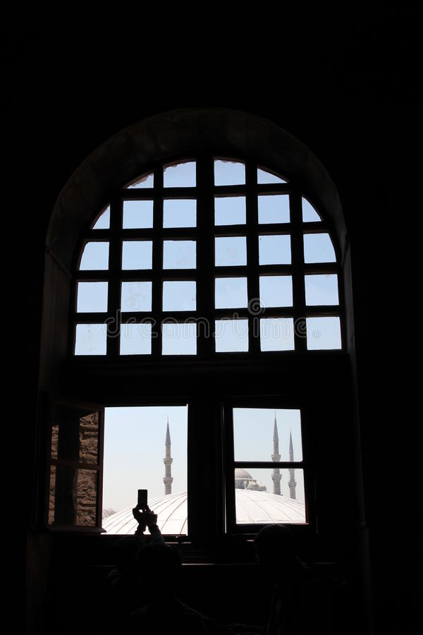 Taking photos of sightseeings, mosques of Istanbul, Turkey. Taking pictures in a mosque in Istanbul, Turkey. Fragments of architecture, window with lights and stock photography