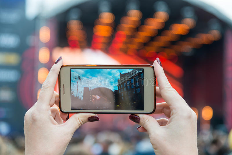 Taking picture at concert. Eurovision 2017 stock image