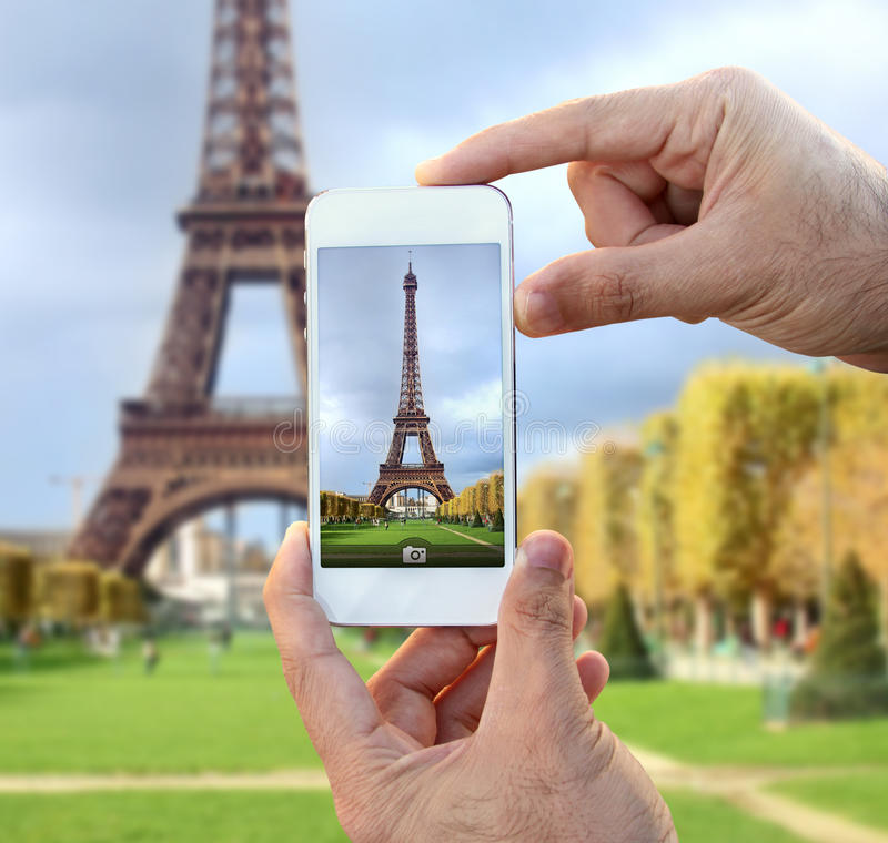 Taking picture of eiffel tower royalty free stock photography