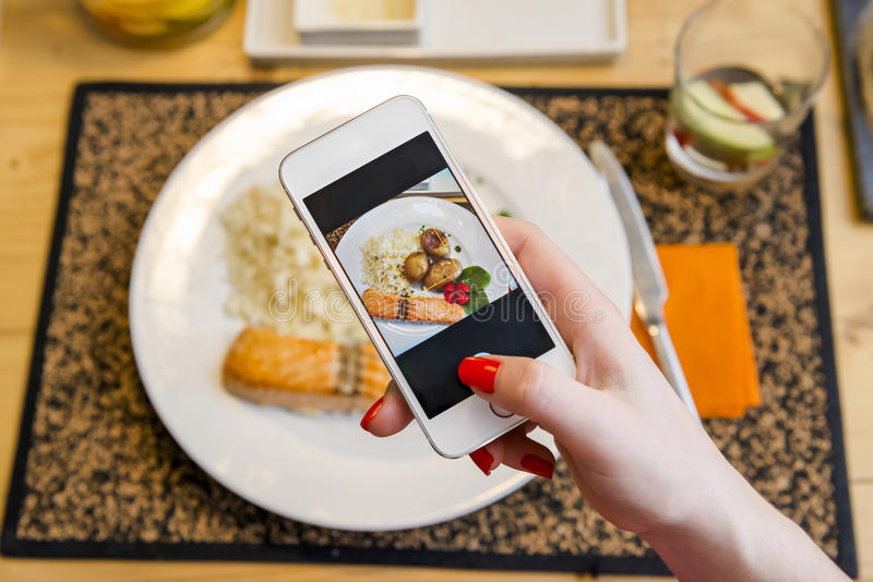 Taking a picture of the food. At the restaurant royalty free stock photography