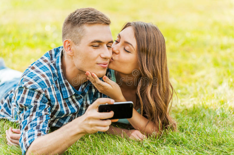 Taking picture of a kiss. royalty free stock image
