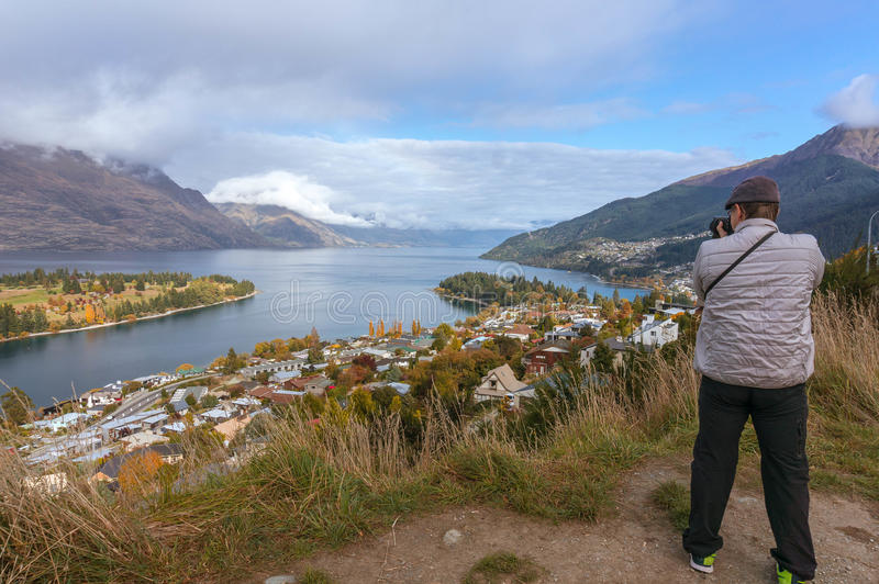 Taking picture of Lake Wakatipu and Queenstown stock image