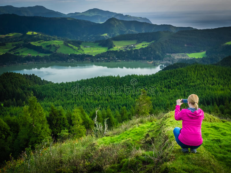 Taking pictures of the Furnas Lake royalty free stock photo