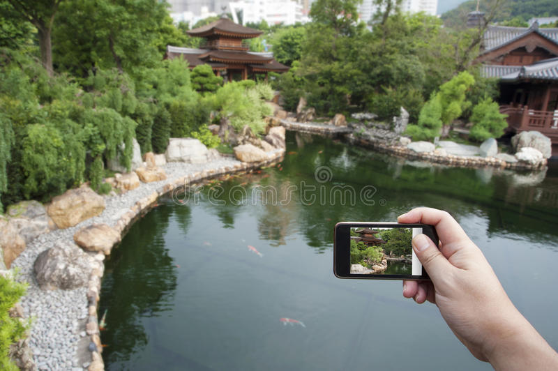 Download Taking Pictures With Smartphone Stock Photo - Image of cityscape, kong: 25131692
