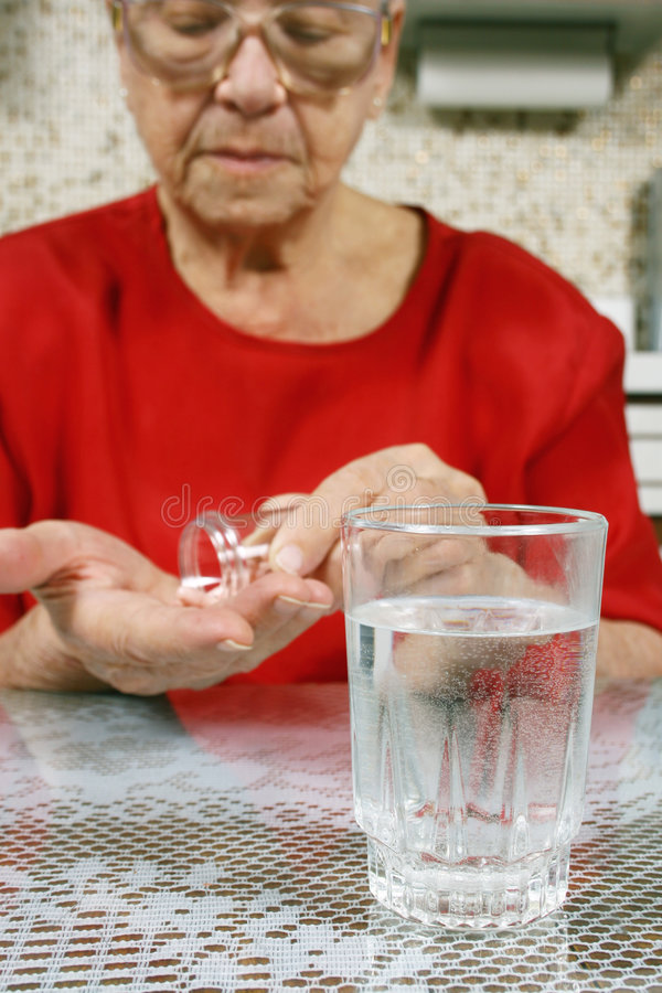 Download Taking pills stock photo. Image of aged, hand, natural - 4109352