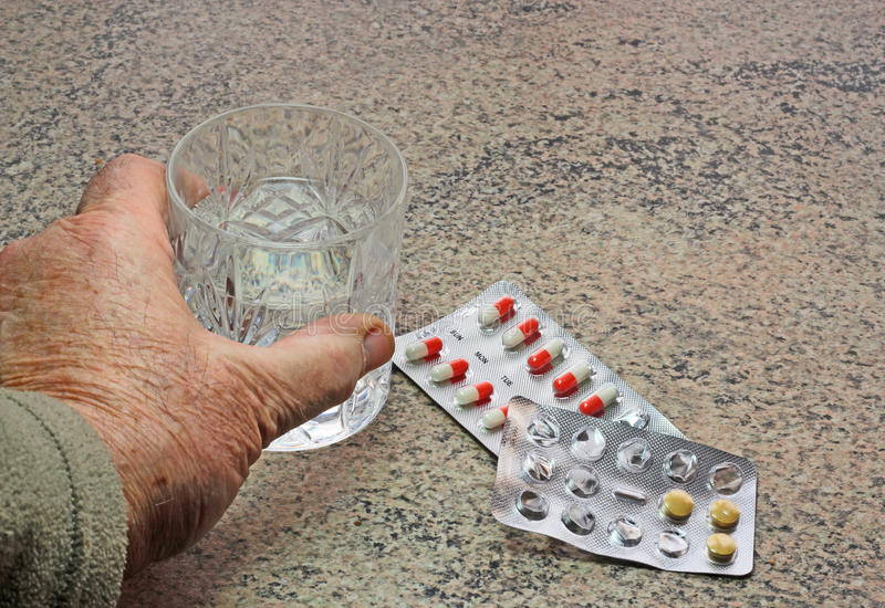 Taking pills. royalty free stock photography