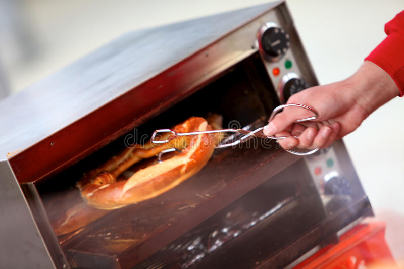Download Taking A Pretzel Out The Oven Stock Photo - Image: 16119376