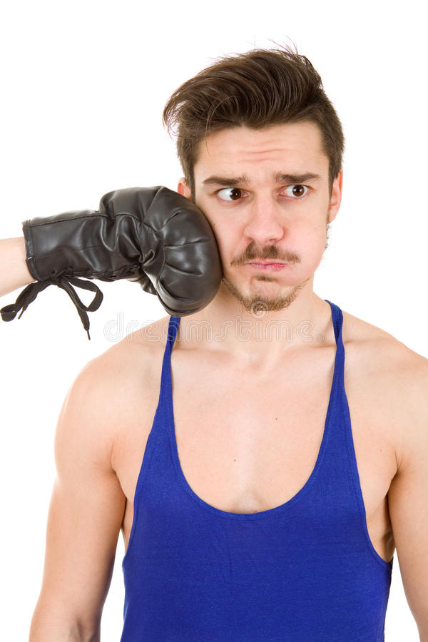 Taking a punch. Man taking a punch with black boxing glove, isolated on white background stock photography